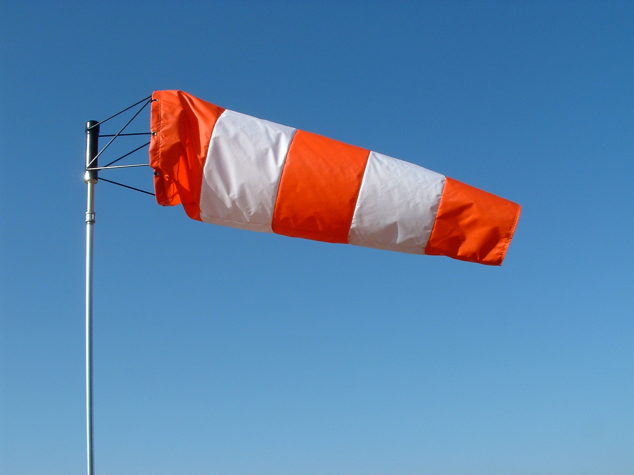 Wind socks with orange and white color stripes